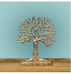 A gorgeously simple aluminium Tree of Life Ornament set upon a natural wooden block base