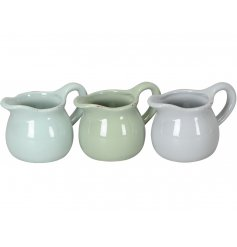 A mix of 3 shabby chic and unique jug planters in charming sage green and grey colours. Each has a rustic finish.