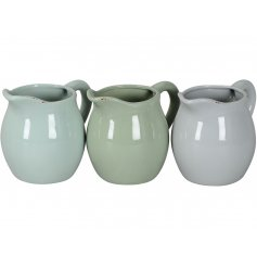 A mix of 3 shabby chic and unique jug planters in stylish sage green and grey colours.