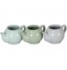 A mix of 3 shabby chic and unique teapot planters in attractive sage green and grey colours.