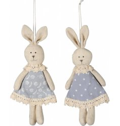 A mix of 2 shabby chic inspired fabric bunny decorations with pretty floral and polkadot dresses.