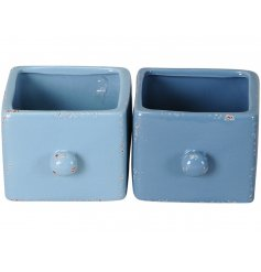 A mix of 2 unique ceramic planters with a rustic finish. The assortment includes stylish blue and navy designs.