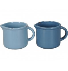 A mix of 2 stylish jug shaped planters in blue and navy hues. Each has a shabby chic finish.