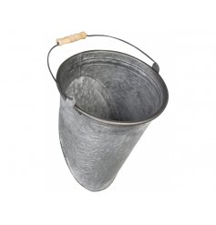 A rustic and unique metal bucket planter with wooden handle. To be fitted to exterior walls.