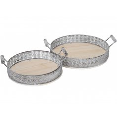 A set of 2 shabby chic inspired round trays with a decorative metal boarder and twin carry handles.