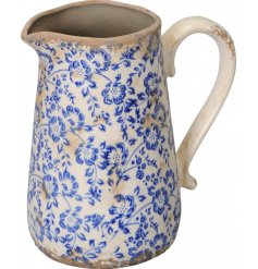 A country living inspired rustic stoneware jug with a beautiful blue floral design and distressed finish.