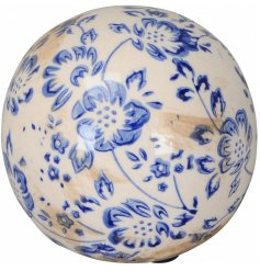 A shabby chic decorative sphere with a beautiful blue floral design inspired by French country interiors.