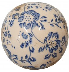A vintage inspired floral decorative sphere with a glazed finish. A country living decoration