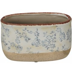 A shabby chic trough planter with a French inspired country floral design.