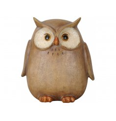 A rustic owl figurine with a rustic finish and carved detailing.