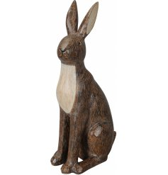 An elegant sitting hare with carved detailing. A stylish interior accessory.