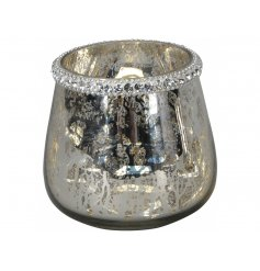 A vintage inspired mirrored glass candle holder with a mottled finish and decorative diamante trim.