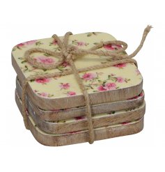 A set of 4 pink rose chunky coasters with a rope bow to finish.