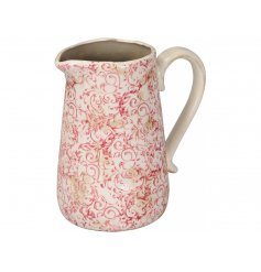 A pretty vintage inspired jug with a country chic floral motif and shabby chic finish.