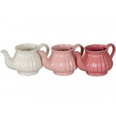 A mix of 3 country chic teapot planters in pretty pink and cream colours. Each has a shabby chic finish.