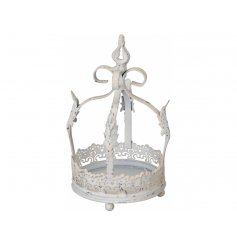 A shabby chic white metal crown with decorative features. Ideal for displaying candles, plants and more.