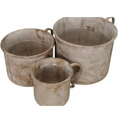 A set of 3 rustic cup shaped planters, each with a distressed finish.
