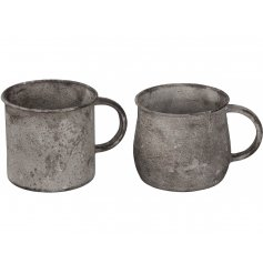 Add character and charm to your home or garden with this mix of two rustic metal mug planters.