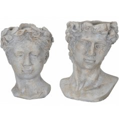 An assortment of 2 antique inspired bust planters in a mix of 2 rustic designs. A romantic garden accessory and gift.