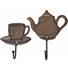 Cast iron hooks featuring a teacup and saucer and teapot. A stylish storage solution for the kitchen and home.