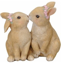An adorable interior accessory. Two beautifully textured and detailed kissing bunnies, complete with pink floral crowns.