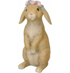 An adorable bunny decoration with a pretty pink floral crown. Complete with realistic detailing.