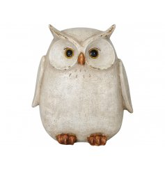 A shabby chic owl decoration with a brown washed finish and distressed detailing. A charming interior accessory.