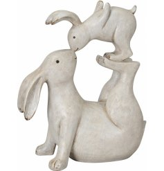 A cute and unique shabby chic ornament featuring playful kissing hares.