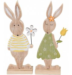 An assortment of 2 wooden rabbit decorations with tulip and daisy flowers.