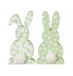 Colourful and cute wooden bunny decorations painted with a bright and beautiful daisy pattern.