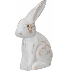 A charming wooden rabbit decoration with a whitewashed, distressed finish.