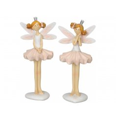An assortment of 2 pretty in pink fairy ornaments, complete with silver crowns and tutus.