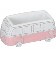 A charming and unique vintage camper van plant pot with a painted finish