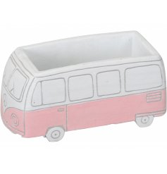 A charming and unique campervan planter with a painted finish and carved details.