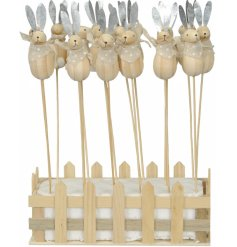 Shabby chic wooden bunny sticks, each with pointed metal ears, fluffy tails and polkadot scarves.