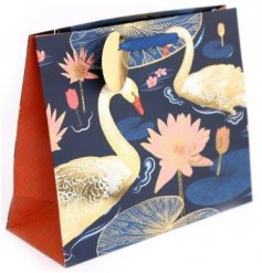A navy blue gift bag featuring a beautiful golden swan inspired decal