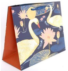 this navy blue based gift bag will be sure to add a special touch to any gift giving event
