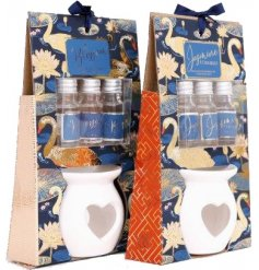 A mix of oil burner candle pots set within beautifully decorated packaging