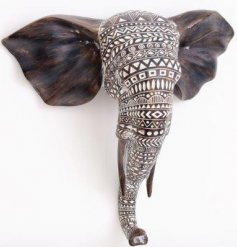 A large Decorative Elephant Bust featuring a distressed aztec pattern