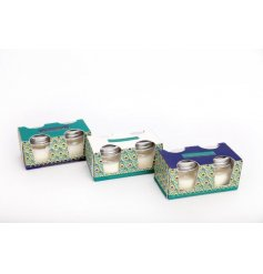 A set of 2 scented candle pots with jewel peacock feather design packaging. A luxury scented gift item for the home.
