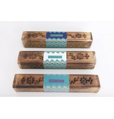 An assortment of 3 patterned wooden boxes encasing scented incense sticks. Complete with a peacock feather print wrap.
