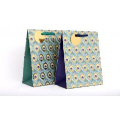 Jewel coloured green and blue peacock feather design gift bags with gold tags and ribbon handles.