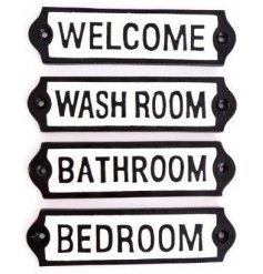 A mix of Cast Iron Plaques, each set with its own bold text decal
