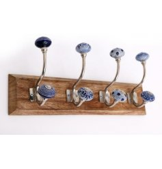 , this natural wooden plaque features 4 blue and white toned hooks