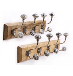 these assorted natural wooden plaque features 4 black and white toned hooks