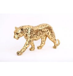 A luxurious leopard ornament with a textured surface and rich gold finish