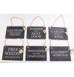 A quirky mix of slate plaques, each decorated with a bold gardening text decal and hanging wooden charm