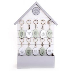 A large assortment of Potting Shed themed keyrings complete with a display stand