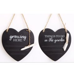 A mix of heart shaped chalkboards, complete with scripted text decals and dotted lines