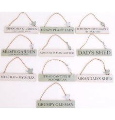 A large assortment of wooden hanging plaques. Each set with a gardening inspired text decal and metal charm